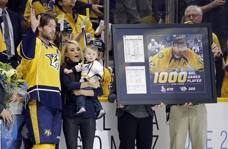 Immagine: Mike Fisher, Carrie Underwood, Isaiah Fisher