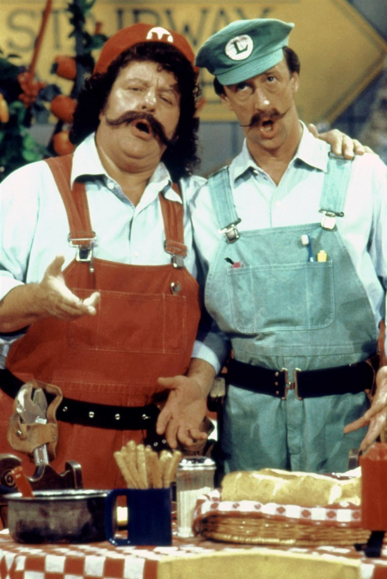 대니 Wells, right, with Capt. Lou Albano on
