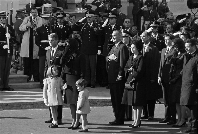 Jacqueline Kennedy, her children Caroline and John Jr., and Attorney General Robert F. Kennedy arrive at the Capitol in Washington, Nov. 24, 1963. They rode from the White House in a procession carrying the slain president's body to the Capitol. Behind them are President Lyndon B. Johnson and his wife Lady Bird Johnson.