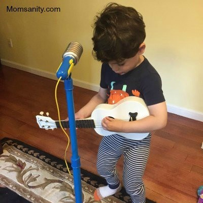 Piccolo boy playing guitar
