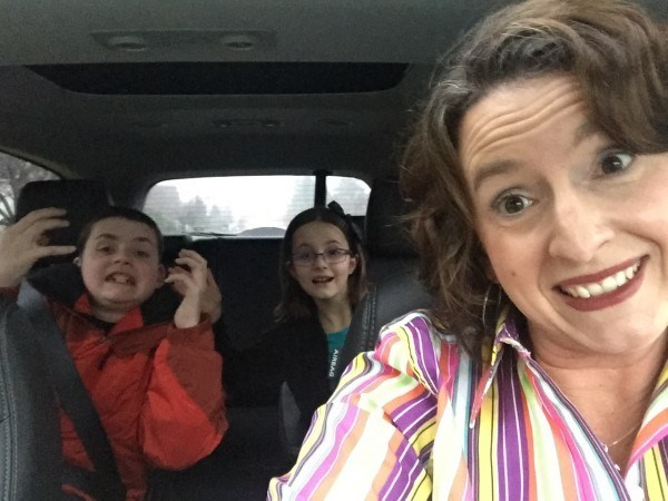 Mamma Christine Burke in car with her kids