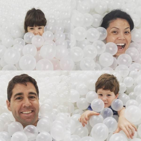 Angie Goff and family playing in a ball pit