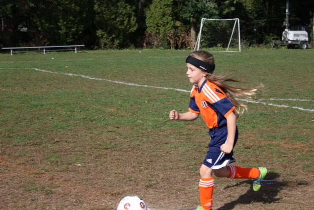 n 8-year-old girl wears Storelli protective head gear while practicing with the Manhasset Soccer Club in Long Island, N.Y.