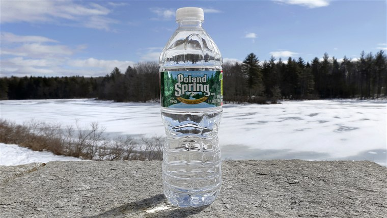 UN bottle of Poland Spring water rests on a granite slab in East Derry, N.H., Tuesday, March 5, 2013.