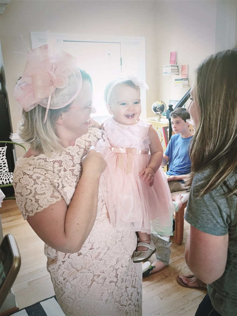 루비 with her mom, Cher, dressed in pink for her first birthday party.