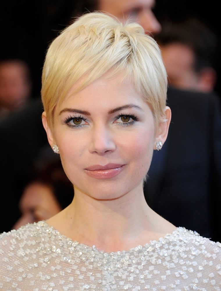 Michelle Williams, in her signature pixie hairdo, arrives at the Academy Awards on February 27, 2011 in Hollywood, California.