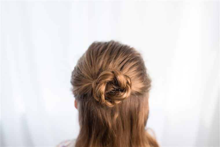 Metà braided up-do hairstyle for kids
