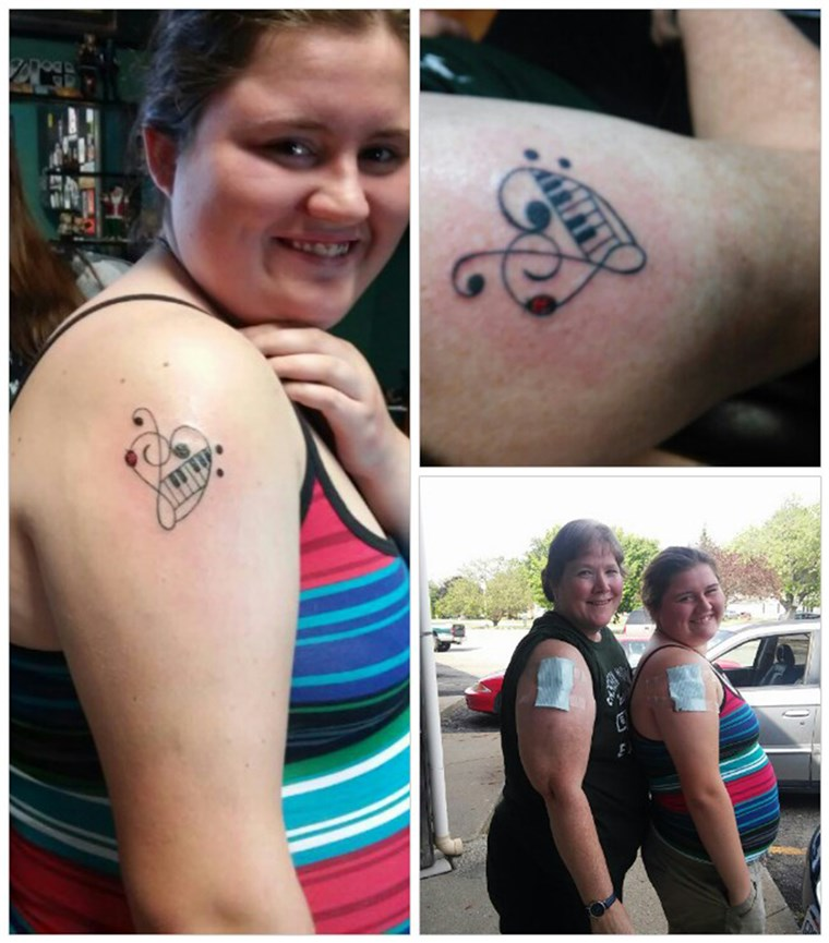 Margie Branch and her granddaughter with their first tattoos at ages 18 and 54.