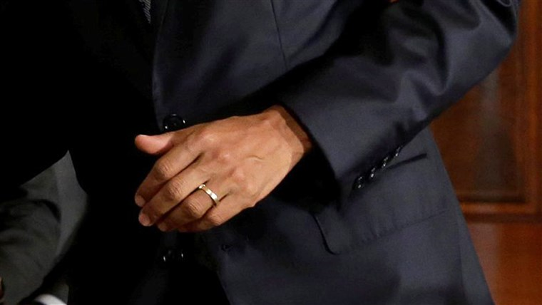 KAMI. President Barack Obama's hand with wedding ring
