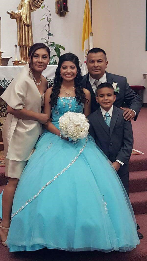 Melati and her family at her quinceanera.