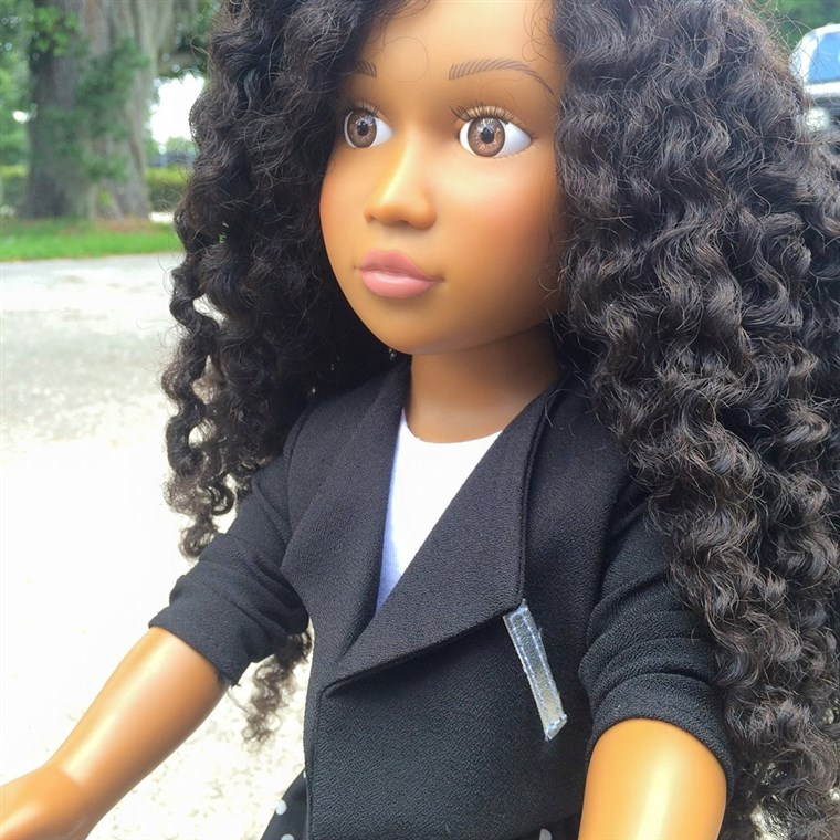 Itu 18-inch doll has washable, natural kinky hair.